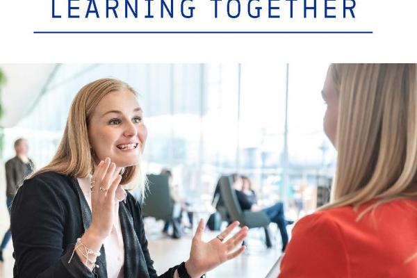 Cover of the brochure Learning Together, with a picture of two experts in lively discussion.